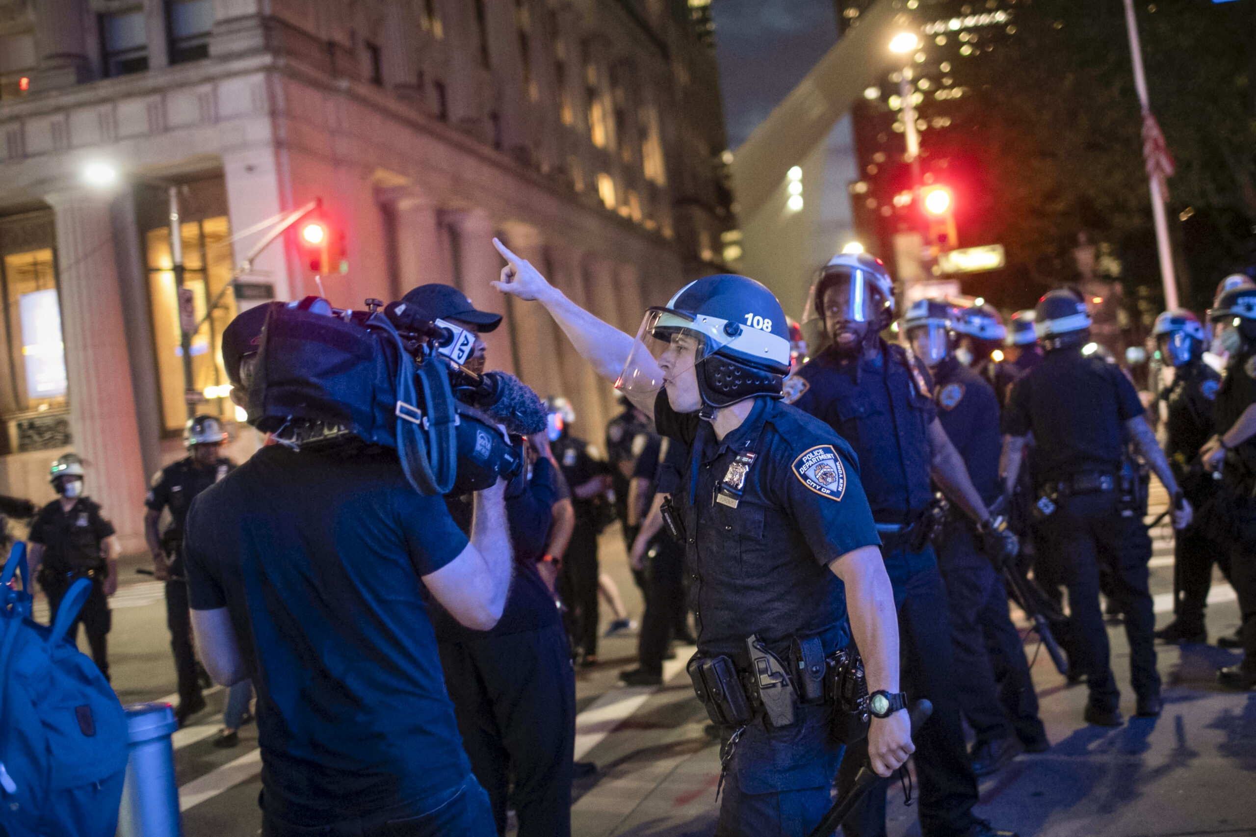 Photo of NYPD officer confronting AP photographer during protests in New York City