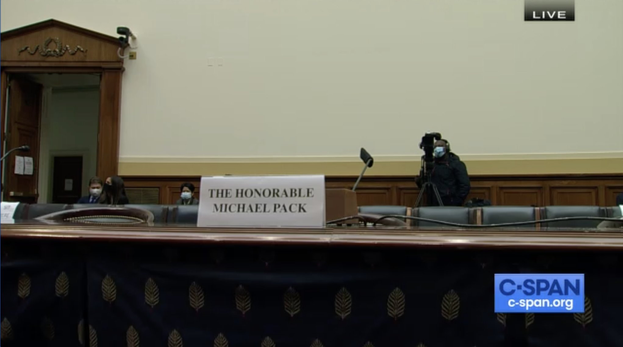 Photo of Michael Pack's empty chair during House Foreign Affairs Committee hearing
